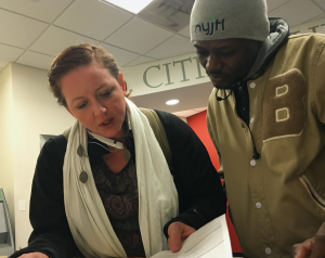 CIVIC volunteer accompanies recently released immigrant to government meeting.